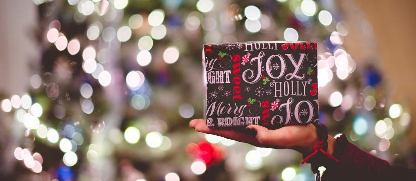 Picture of a wrapped gift under a Christmas tree