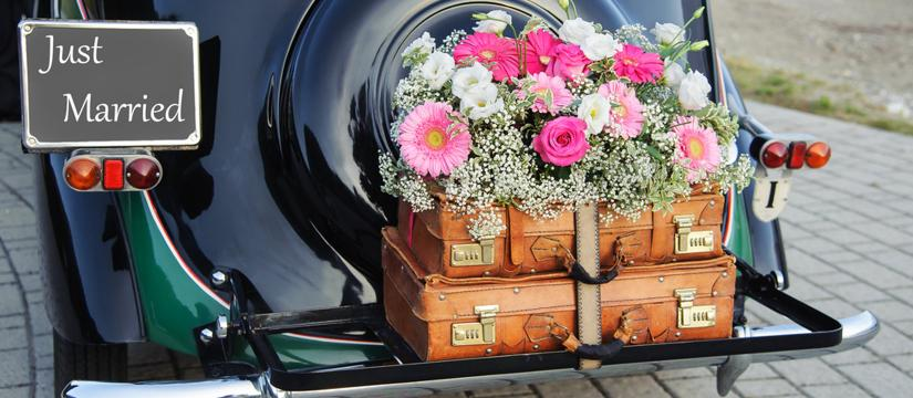 Flowers on the back of a wedding car