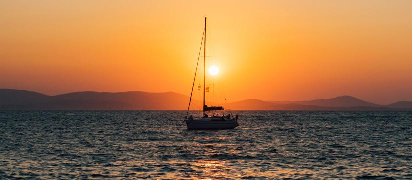 Small sailing boat at sunset